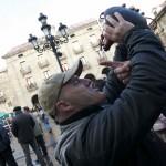 Día de San Sebastián. Reinosa. Rodolfo Montero (Director y Productor de cine)bebe en bota.